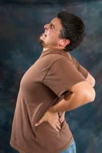 backache man - Expressing Anger Appropriately is a natural Pain Relief Mechanism