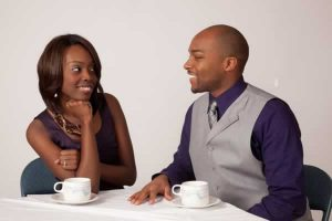 african american couple smiling over coffee